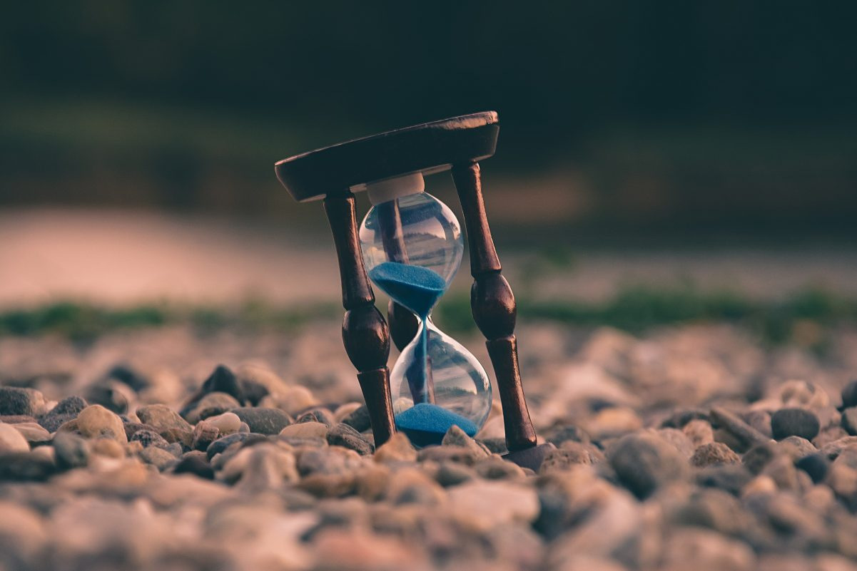 An hourglass in sand